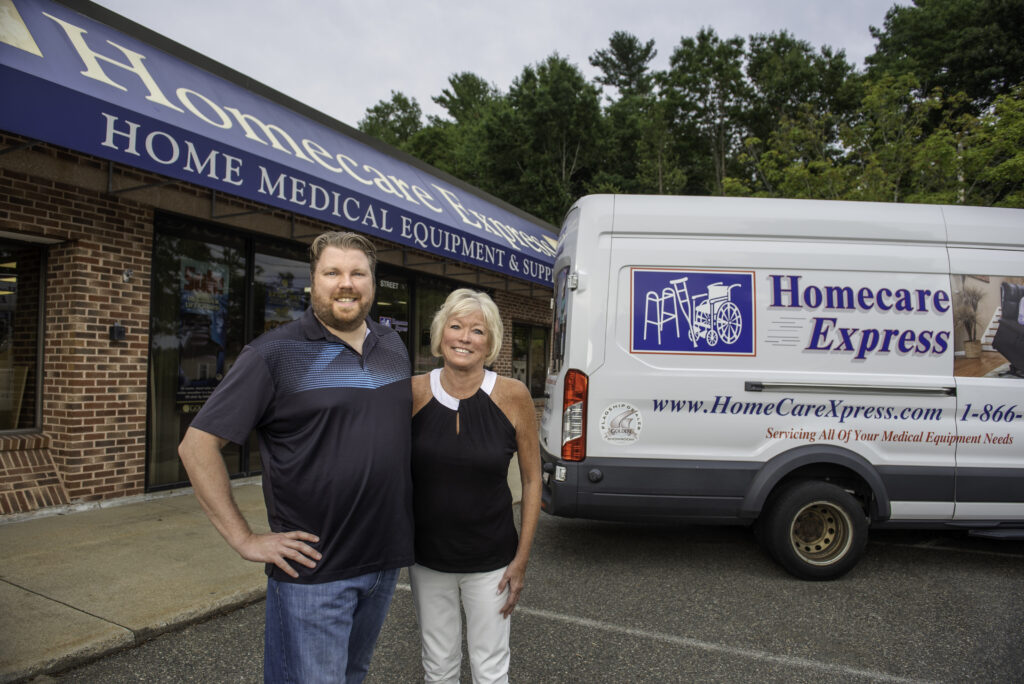 Mike and Dianne in front of the store